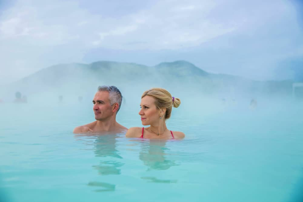 A couple enjoying a relaxing soak at one of the top hot springs in Montana near our Missoula Bed and Breakfast